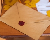 A sealed envelope placed on top of a table | photo credit: pexels.com (John-Mark Smith)