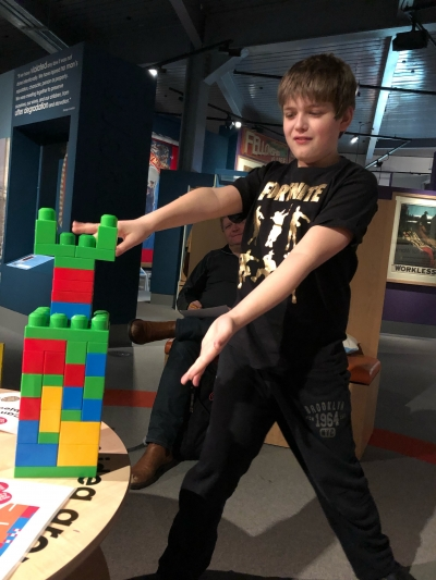 A boy building with lego bricks at People's History Museum
