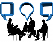 illustration of a number of people chatting, as if in a meeting/ consultation, with chat balloons | photo credit: Gerd Altmann via pixabay.com