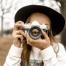 A woman holding a camera   image source: Pexels.com