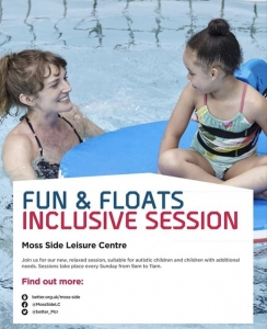 Image is a photograph of a woman stood in a swimming pool, smiling at a young girl who is sat on-top of a pool float