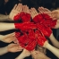 A bunch of painted hands together forming a red heart shape | Image credit: Tim Marshall via Unsplash.com