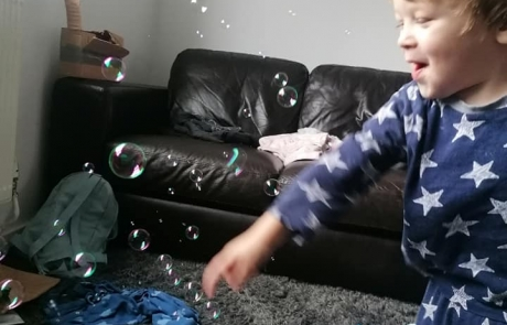 A boy playing with bubbles