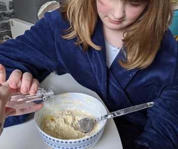 A girl making some homemade moon sand.