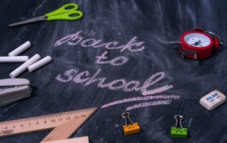 "A blackboard with the words ""Back to School"" written on it 