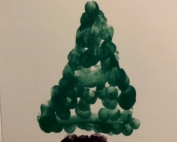 "A finger-painted Christmas tree plus the words ""Happy Lockmas 2020"""