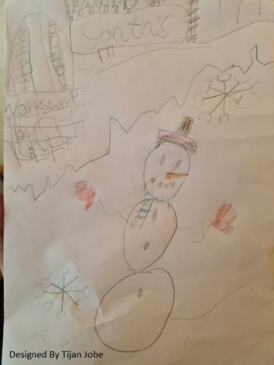 A snowman standing in front of Santa's workshop