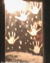 hand prints and falling snow, painted on a mirror