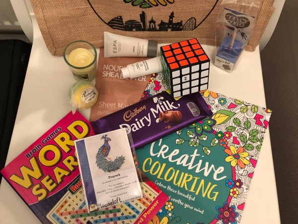 contents of the Parent/Carer Well-being Packs from Manchester Parent Carer Forum & 4CT: MPCF bag, pamper items, activity booklets, chocolates, etc