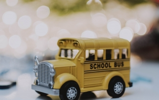 A toy yellow school bus